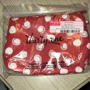 Thirty one mini zipper pouch. Swirl dot pattern
